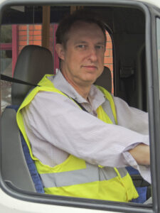 Peter Haley CEO driving a minibus